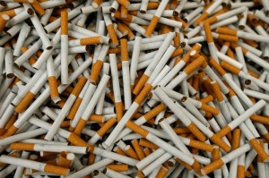 Cigarettes are seen during the manufacturing process in the British American Tobacco Cigarette Factory (BAT) in Bayreuth, southern Germany, April 30, 2014. British American Tobacco, the world's No. 2 cigarette maker, posted improved sales volume for the first quarter, though foreign exchange rates were a big drag on revenue. Picture taken April 30, 2014. REUTERS/Michaela Rehle (GERMANY - Tags: BUSINESS)